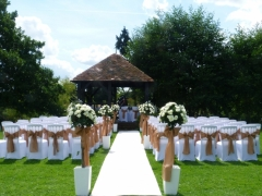 Prested hall with aisle carpet and rose trees