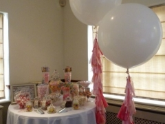 Candy-buffet-with-jumbo-balloons-with-tassels-1