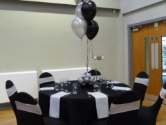 black lycra with silver band and silver napkins