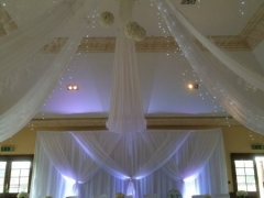 Grecian-backdrop-with-ceiling-drapes