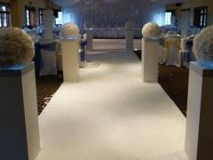 faux-rose-ball-columns-lining-aisle
